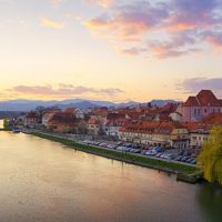 Train-travel-in-Slovenia-Maribor-and-river